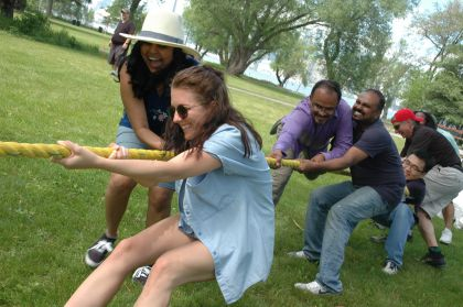 Seven people compete in a tug of war