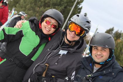 Three people in ski gear pose for a photo